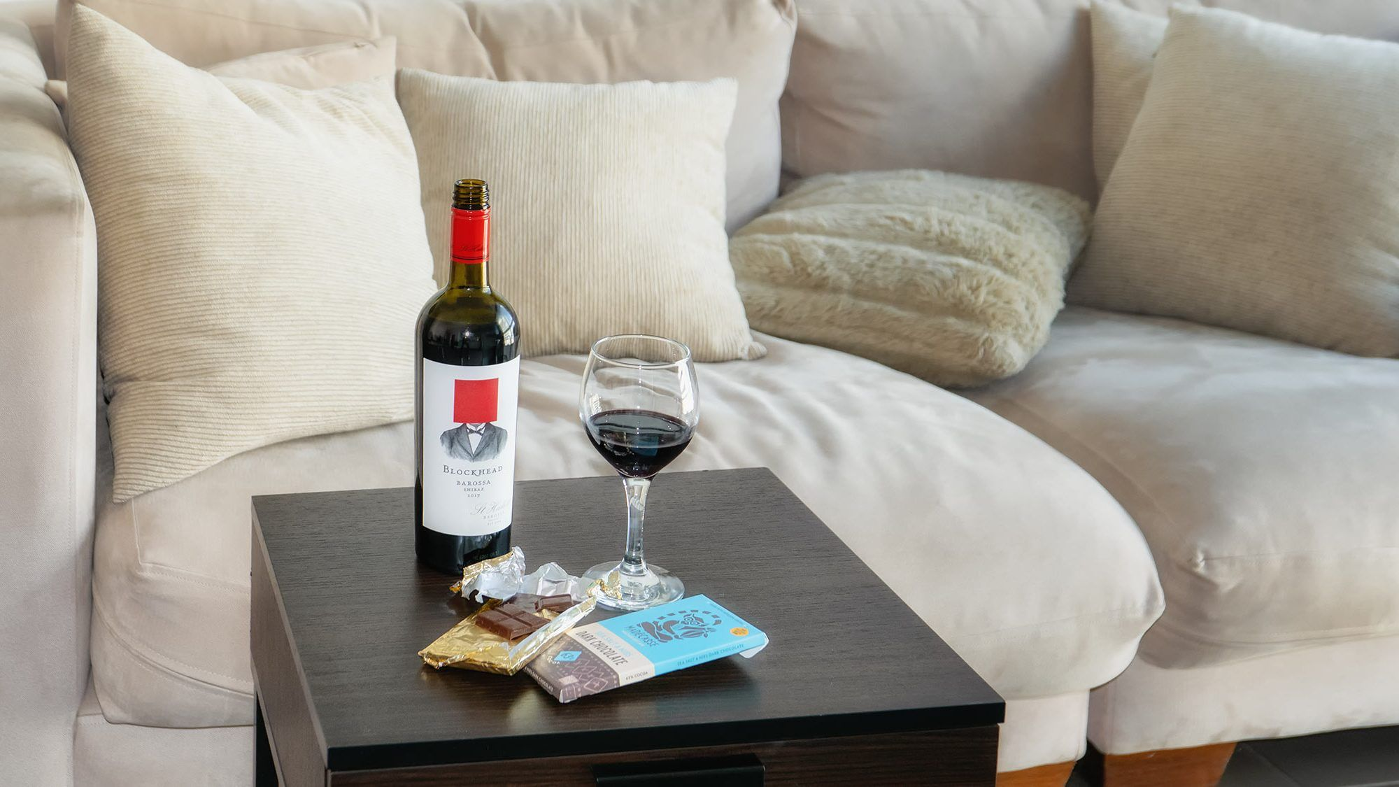 shiraz red wine and chocolate on a table