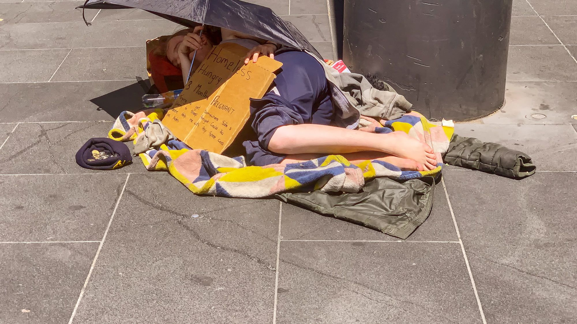 pregnant and homeless woman sleeping on the floor