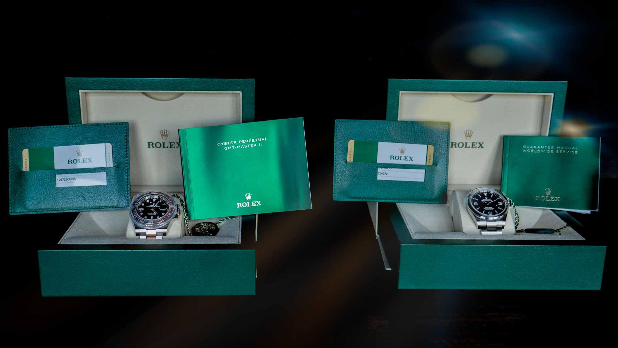 neu gekaufte Rolex Uhren in grüner Verpackung